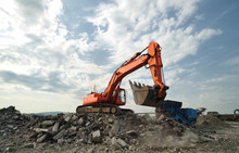 Working Activity On Demolition Construction Site. Crawler Excavator And Stone Breaker Machinery Working On Demolition Site.