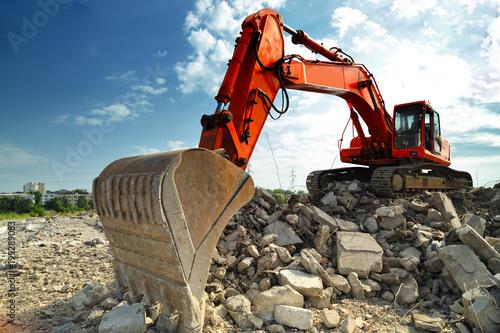 Crawler excavator on demolition site Wallpaper Mural