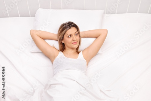 Fotografie, Obraz  Woman lying in bed and daydreaming