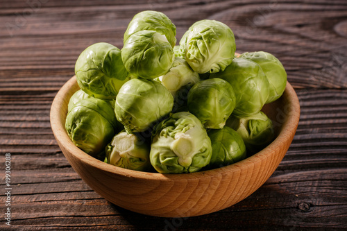 Foto op Canvas Brussel Brussels sprouts on a rustic wooden background