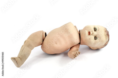 Fototapeta Close Up and Isolated Vintage Antique Old Doll