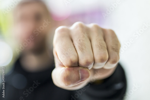Fotografía  A man fists clenched, focused on the fist