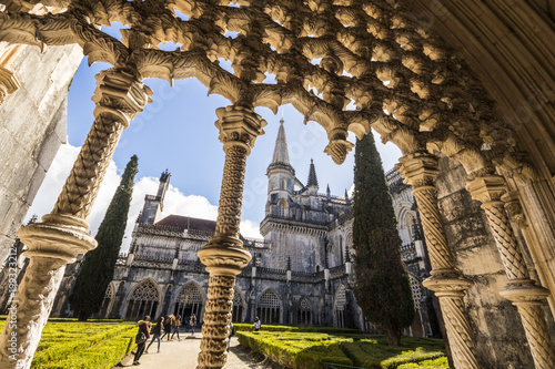 Foto op Canvas Monument Manueline flamboyant gothic carved windows in the Royal Cloister (Claustro Real) of Batalha Monastery, Portugal