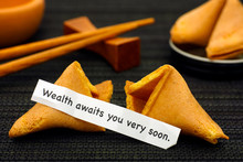 Paper Strip With Phrase Wealth Awaits You Very Soon From Fortune Cookie