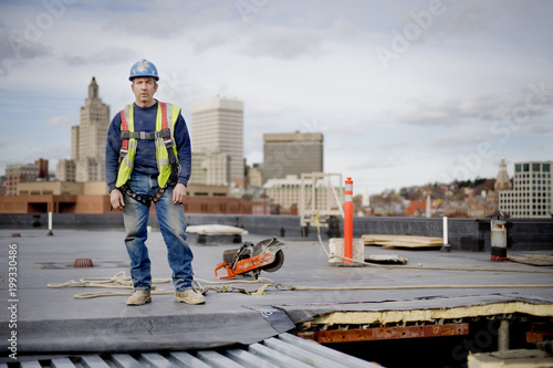 Portrait of worker standing on building