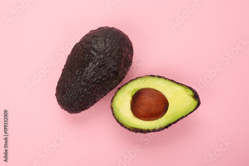 Fotografie, Obraz  Top view of a ripe sliced avocado isolated
