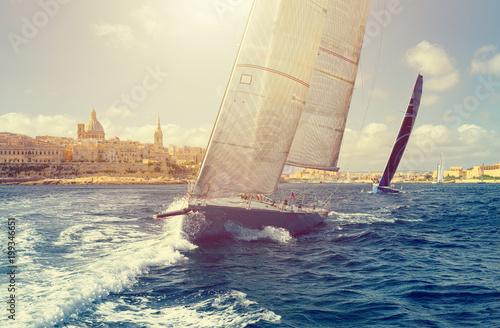 Sailing yacht in the sunlight. Sailing yacht regatta. Yachting