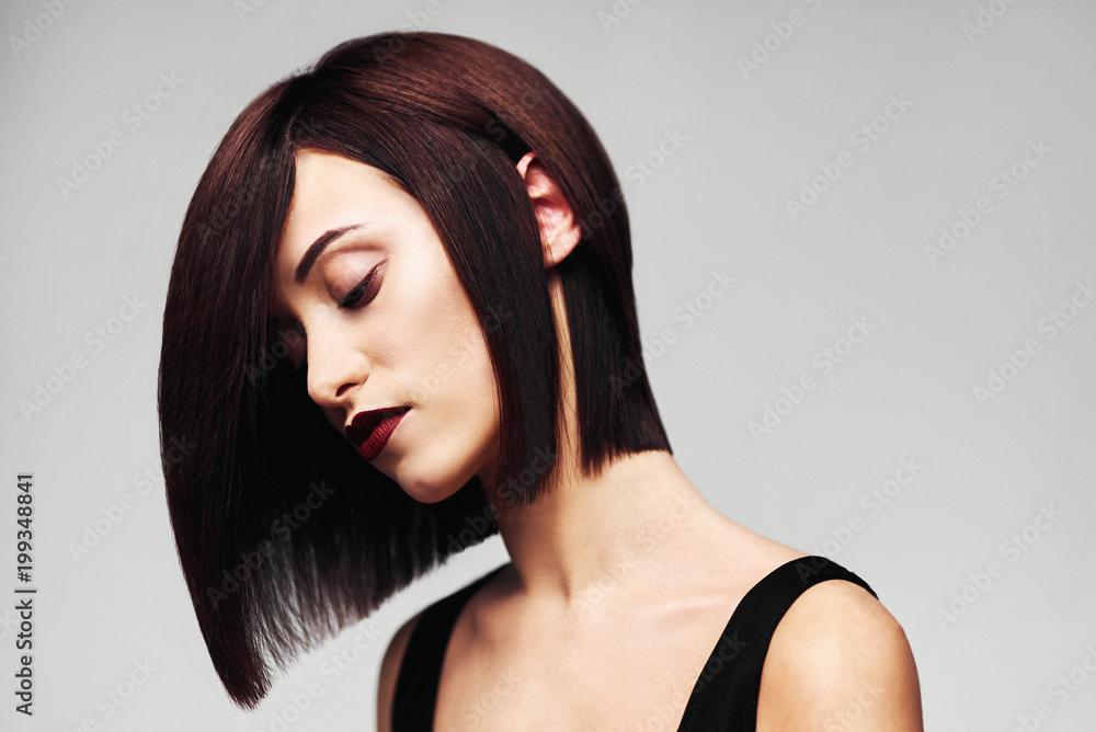 Fototapeta Model with perfect long glossy brown hair. Close-up Bob haircut portrait