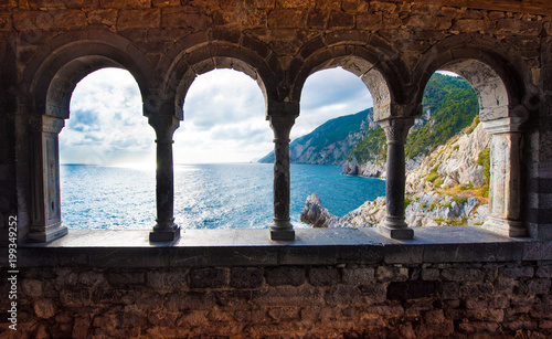 Poster de jardin Europe Méditérranéenne magical sea view through the castle and gothic Church of St. Peter arches in Porto Venere, Liguria, Italy