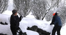 Man And Woman In Snowball Fight Outdoor On Snowy Winter Afternoon.