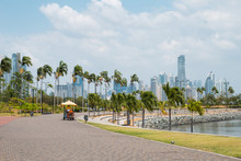 Sidewalk At Public Park With City Skyline At Coast Promenade In Panama City -