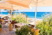 Restaurant Terrace In Front Of The Beach In Kamari On The Island Of Santorini