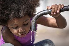 African American Child Drinkin...