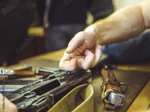 Fotomural master disassemble repair and clean the auto assault rifle gun