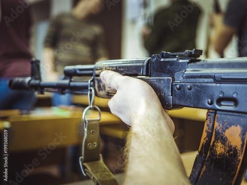 Aluminium Prints Scooter close up assault weapon rifle on the table auto shootgun