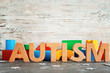 "canvas print picture - Word ""Autism"" and building blocks on table"