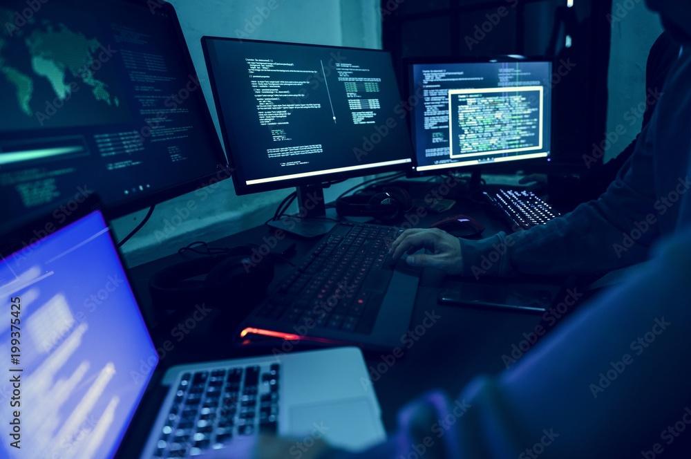 Fototapeta Diverse computer hacking shoot