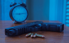 Gun On Bedroom Night Stand With Bullets