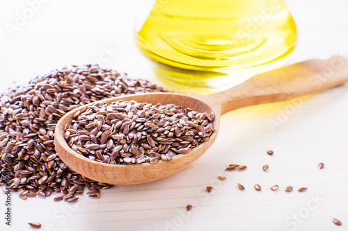 Flax Seeds In A Wooden Spoon Next Flaxseed Oil On An Old Board