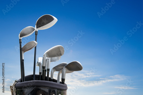 Golf equipment on green field background.