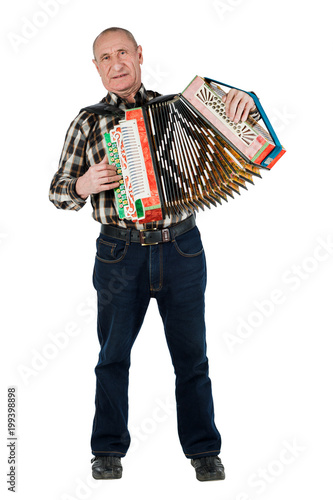 Portrait of a man, grandfather playing the accordion Fototapet