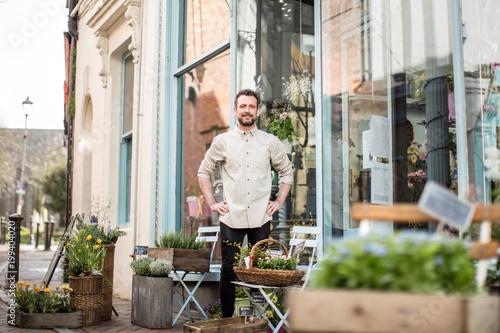 Portrait of a florist outside store