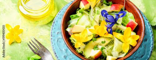 Fresh vegan salad with edible flowers