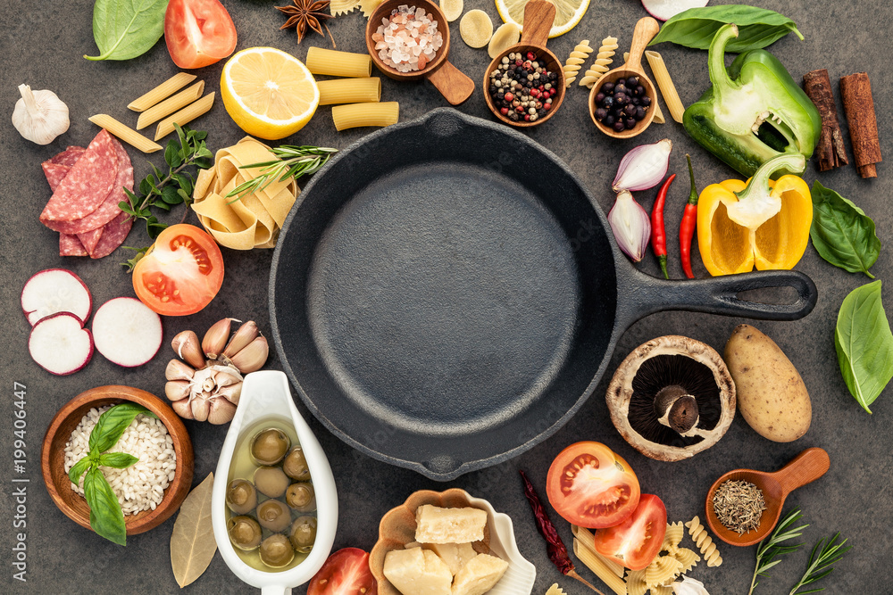 Fototapety, obrazy: Italian food cooking ingredients on dark stone background with  cast iron pan flat lay and copy space.