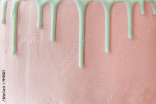 Stampa su Tela The front side of the pink cake with cream drips. Copy space