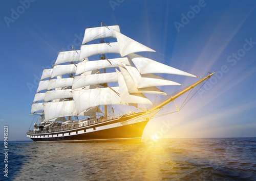 Sailing ship and sun rays. Sailing. Yachting