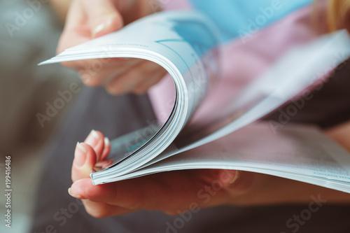 Obraz na plátně  woman reading magazine at home