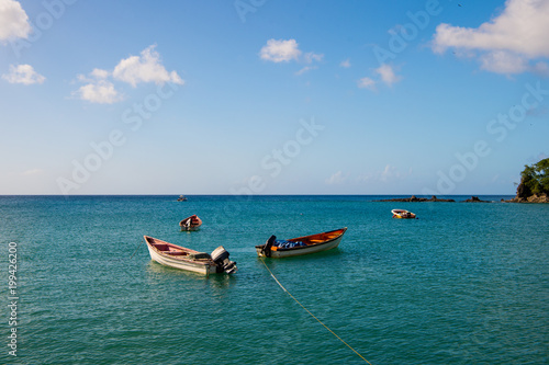 Fishing boats in blue sea on sunny sky in castries, st.lucia. Summer vacation in tropics. Fishing and recreation on tropical island. Travel by boat and wanderlust concept