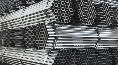 Fotografia  Stack of steel pipes in warehouse