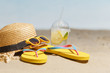 Flip flops, sunglasses and accessiores on sandy beach. holidays background. Copy space.