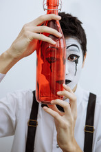 Mime With A Bottle. The Alcoho...