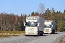 Two White Semi Trucks Platooning