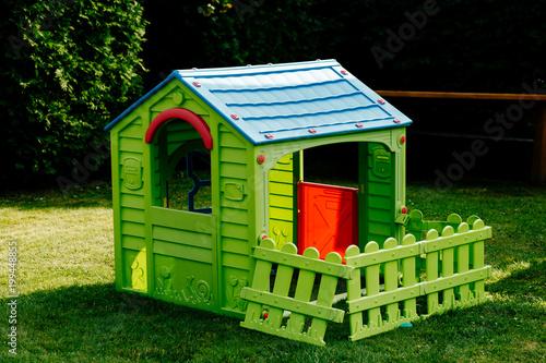 Fototapeta children's plastic house on the lawn