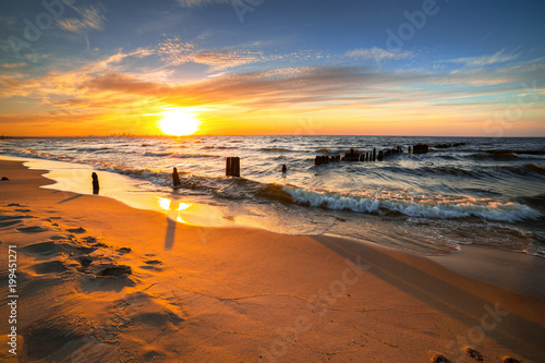 Poster Zee zonsondergang Sunset ovet the Baltic sea beach in Poland