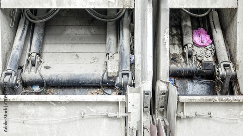 Fototapety, obrazy: Dirt and garbage in the rear of a smelly garbage truck.
