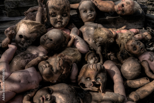 Photo  Creepy Broken Old Dolls