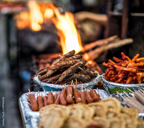 Freshly Fried Fish Sausages And Deep Fried Chicken Feet Near The