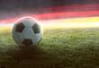 canvas print picture Fußball vor deutschlandfarbenden Lichteffekten