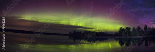Fotografia, Obraz  Northern Lights over a Lake in Minnesota during Summer