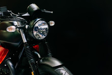 Close Up Shot Of  Headlight Of New Modern Black Motorcycle On Black Background With Copy Space For Your Text