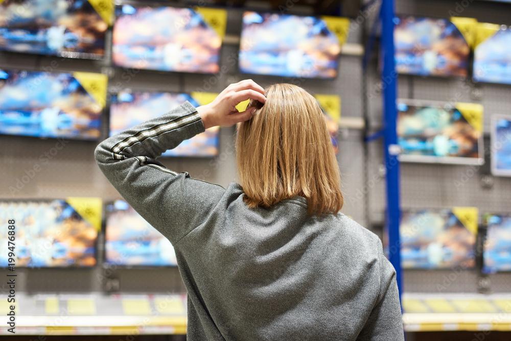 Fototapeta Buyer woman and TV in store