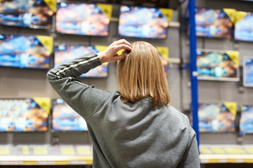 Buyer woman and TV in store