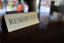 Reserved Sign On Wooden Table ...