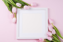 White Square Frame Mockup With White Tulips Against A Pink Background