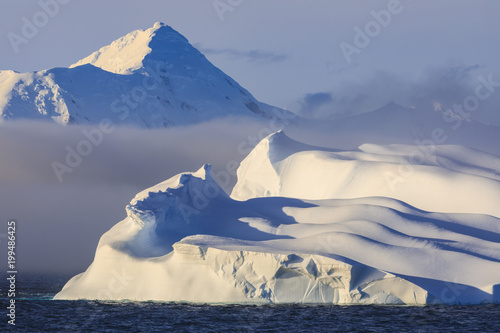 Spoed Foto op Canvas Antarctica Huge non-tabular iceberg, mountains, evening light and mist, Bransfield Strait, South Shetland Islands, Antarctica, Polar Regions