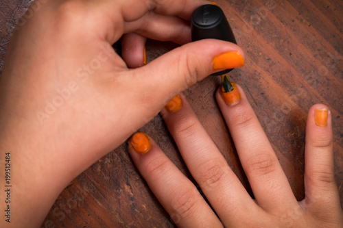 Fotografie, Obraz  Painting nails orange